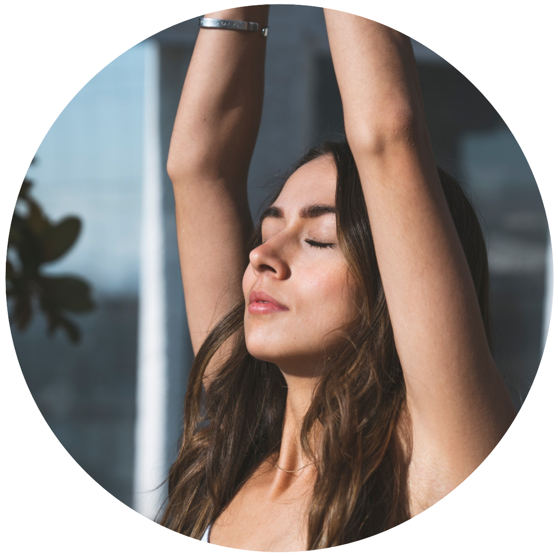 Woman with hands stretched above her head in the gesture of connecting to her inneWoman with hands stretched above head breathes calmly in gesture of connection with her higher self and wisdomr self
